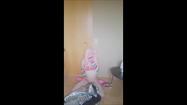 cutie crossdresser with pink bikini comes on shiny puffy jacket