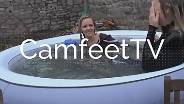 Blonde throws herself in the pool barefoot underwater