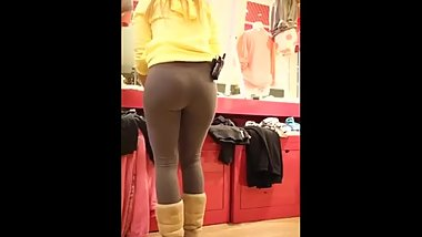 Candid blonde teen cutie in leggings at work