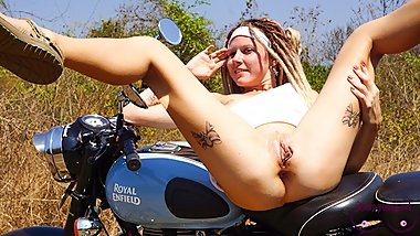 Outdoor anal sex with James Bong's girl on the motorbike. Pussy 0%