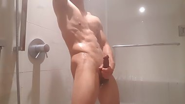 Fit college student jerking off in shower