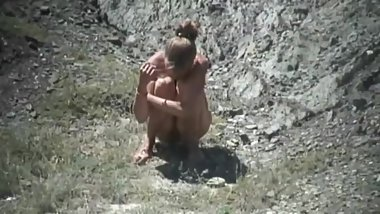 girls peeing in the dunes II